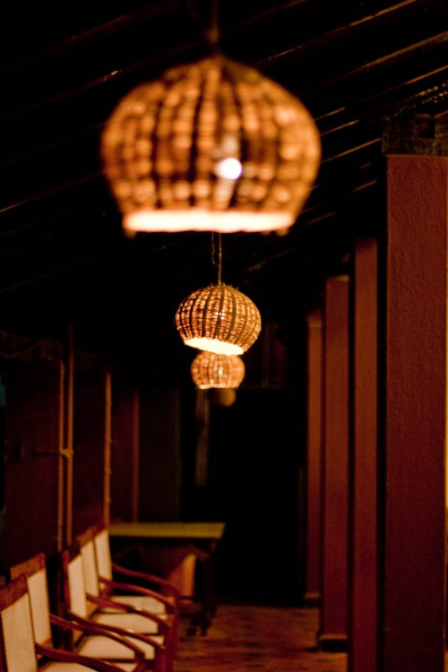 Dim light photography of section of restaurant souza lobo at Calangute