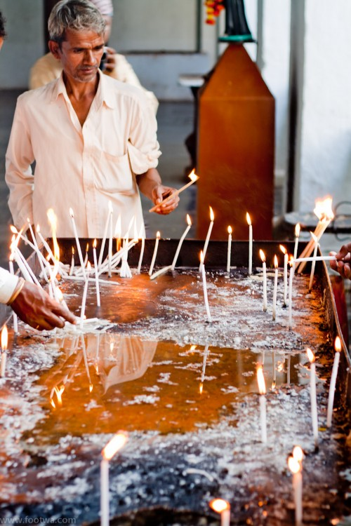 Man lighting a candle, Basilica of Bom Jesus, Candid, faith, lighting a candle, Man lighting a candle, Old Goa, People, Portrait, prayer, Photographer Anurag Jain