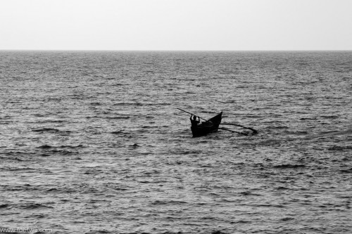 Solitary canoe at sea
