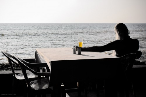 Old man with a beer at Anjuna, Anjuna, Beer, Goa, man overlooking the sea, People, Portrait, salt and pepper, simple life, View of the sea from a restaurant, Yogi, Photographer Anurag Jain