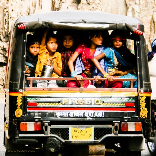 Kids on their way to school in an auto