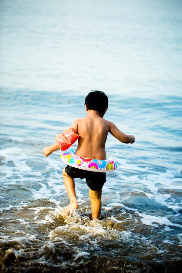 Adi stepping into the sea